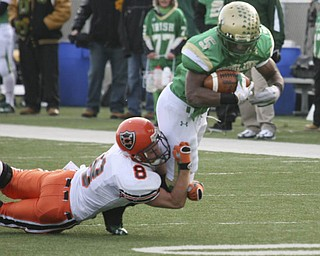 During the second quarter, Ursuline's #5 Jesse Curry gets stopped by Coldwater's #8 Ross Wermert. The Irish have achieved their primary season goal: to win a third-straight Division V State Championship title. The Fighting Irish had an impressive end to their season with a 51-21 victory over Coldwater at Canton's Fawcett Stadium Saturday, Dec. 4, 2010.