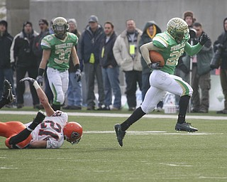 Ursuline's Akise Teague scores a touch down, and leaves Coldwater'ss #21 Reese Klenke in a heap during the Division V State Championship game Saturday, Dec. 4, 2010, at Canton's Fawcett stadium.