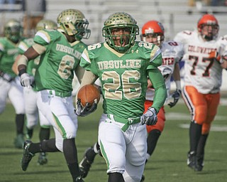 Ursuline's Akise Teague's first of five touchdowns. The Ursuline Irish achieved their primary season goal: to win the state title for a record third-straight time. The Fighting Irish had an impressive end to their season with a 51-21 victory over Coldwater in the Division V State Championship game at Canton's Fawcett Stadium Saturday, Dec. 4, 2010.