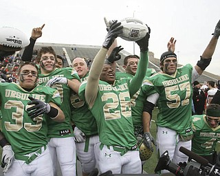 Ursuline's #33  Jeff Podolsky, #26 Akise Teague and  #57 Michael Zappa  hold up championship trophy footballs as they celebrate the win over Coldwater. The Ursuline Irish have achieved their primary season goal: to win the state title for a record third-straight time. The Fighting Irish had an impressive end to their season with a 51-21 victory over Coldwater in the Division V State Championship game at Canton's Fawcett Stadium Saturday, Dec. 4, 2010.