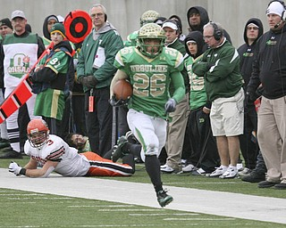 All Coldwater'ss #3 Aaron Rummel can do is watch as Akise Teague goes for yet another touchdown. Teague scored five touchdowns in the Division V State Championship game at Canton's Fawcett Stadium Saturday, Dec. 4, 2010.