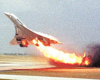 Air France Concorde flight 4590 takes off with fire trailing from its engine on the left wing from Charles de Gaulle airport in Paris, in this July 25, 2000 file photo.  The plane crashed shortly after take-off, killing all the 109 people aboard and four others on the ground. A decade after a supersonic Concorde jet crashed in a fiery wreck outside Paris soon after takeoff, killing 113 people, a French court will rule at last Monday Dec 6 2010 on who, if anyone, is to blame.