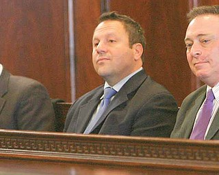 Mahoning County Commissioner John McNally, Auditor Mike Sciortino and Joe Bell listen as attorneys made arguments Monday at the Mahoning County Courthouse during a the hearing on the Vindicator's and 21 WFMJ-TV's motion to unseal Oakhill criminal conspiracy case filings and on the Cafaro Co.'s motion to dismiss the indictment.