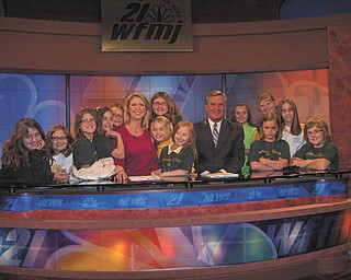 Up close and personal: A visit to the WFMJ-TV studio in Youngstown was an enlightening experience for a group of fourth-grade girls from Holy Family School, on Center Road in Poland. Led by Tina Kali, who along with Melanie Jones planned the event, the Acts of Random Kindness girls toured the studio and heard a talk by Madonna Pinkard, public relations representative. They also viewed a live news broadcast by studio personalities Cindy Matthews, Bob Black, Dana Balash and Mark Koontz. As a memento of the occasion the group posed for an official picture. Gathered for the event are, from left, Simone Izzo, Jayda Benson, Jessie Cummings, Angelina Sabatino, Brooke Chandler, Matthews, Isabella Massaro-Suchora (back), Aidan McDanel, Angelina Santora, Black, Katherine Kali, Anna Nietzel (back), Marissa Mangino, Lauren Perchak and Hannah Balash.