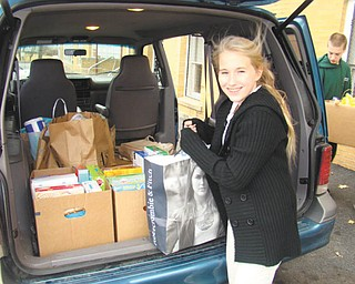 Caring and sharing: Students at St. Patrick School in Hubbard had an opportunity recently to show that they care about the needy in the community. During two special dress-down days they collected canned goods, paper products and other helpful items to be shared with those in need. Sandy Slenker, above, is shown as she helped load the items into a van for pickup and distribution to the less fortunate by members of the St. Vincent de Paul Society, which operates a food pantry at St. Patrick Church.
