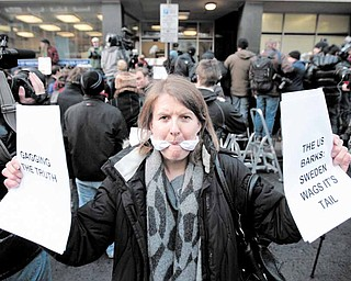 A supporter of  Wikileaks founder Julian Assange, poses for members of the media outside the City of Westminster Magistrates Court in London where Julian Assange's case was heard, Tuesday, Dec. 7, 2010. Julian Assange was jailed Tuesday after the WikiLeaks founder told a London court he would fight efforts to extradite him to Sweden, where he faces a sex-crimes investigation.