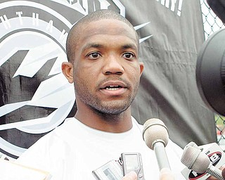 "This Sept. 1, 2010, file photo shows Maurice Clarett speaking to reporters following team practice with the United Football League's Omaha Nighthawks,  in Omaha, Neb. Clarett says he would spend another year with the UFL's Omaha Nighthawks if they want him back. He told The Associated Press that the Nighthawks' opportunity has been ""a blessing from God."""