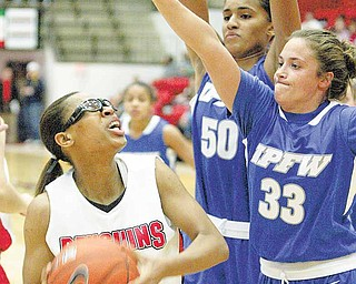 YSU's Kenya Middlebrooks is hemmed in by IPFW's #50 Sydney Weinert  and #33 Jordan Zuppe  during first half action Saturday, Dec. 4, 2010, at YSU.
