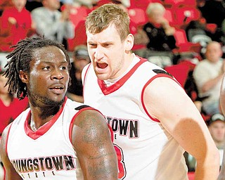 YSU's Ashen Ward (20) and Dan Boudler (33) during the second half of a game at YSU's Beeghly Center on Tuesday evening.