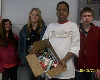 The freshmen at Struthers High School participated in The Vindicator's Operation Holiday Cheer project recently. The students put together 17 packages and wrote 180 letters to send to area soldiers. Among those involved in the project were, from left, Marissa Fusco, Marissa Stone, Don Barnes and Travis Gartlic.