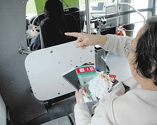 Barbara Altman, 56, points the bus driver in the right direction.