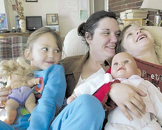 Joyce Koellner and her daughters Colleen, left, and Corra, 6, at Beatitude House.