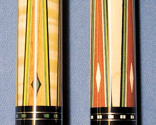 Pool cues made by former Valley resident Mike Gulyassy, owner of Baby's Pro Shop in Greenville, S.C., are high-end cues made from ivory, elephant skin, tulip wood (left) and red heartwood (right). Gulyassy designs special cues for Strickland.