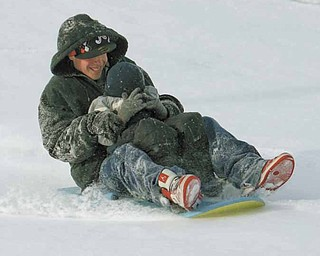 John Hallett takes his little brother Steve Hallett for a ride down a sledding hill at the Wick Recreation Area.