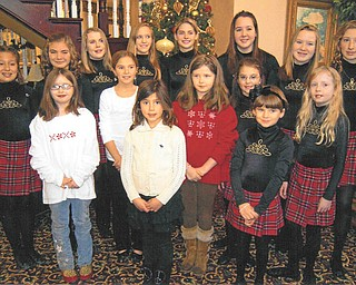 Spreading good, old-fashioned cheer: On Dec. 12 members of the Junior Division of the Golden Rose Queen of Ireland LAOH of Mahoning County presented Christmas shows and took homemade cookies to residents at two nursing homes as a service project. First, the juniors performed at noon at Assumption Village, where they gathered by the Christmas tree, above, for a group picture. They also sang all the favorite Christmas songs, followed by an exhibition of Irish Dance by students of the Theresa Burke School of Irish Dance. At 2 p.m. the juniors presented the program and cookies to residents at the Inn at Christine Valley, where Shamus Kerrigan, grandfather of juniors Vice President Christine Kerrigan, is a resident. Christine qualified in the Midwest Oireachtas to compete in the World Irish Dance Championships in Dublin, Ireland, in 2011.