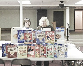 Bowled over by cereal: Austintown Kiwanis, led by Vice President Mary Ann Herschel, left, and President Carole Powers, collected more than 40 boxes of cereal as a Christmas project for the club. The cereal will be donated to the Salvation Army to be given to needy families in the area. The club designates the last Wednesday of each month as Kiwanis Cereal Day to help the Salvation Army all year long.