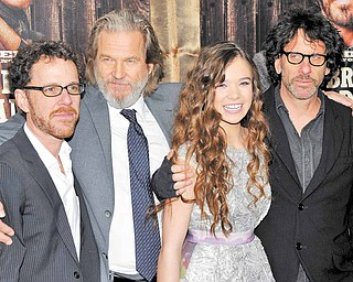 From left, co-director Ethan Coen, actor Jeff Bridges, actress Hailee Steinfeld and co-director Joel Coen attend the premiere of 'True Grit' at the Ziegfeld Theatre on Tuesday, Dec. 14, 2010 in New York.
