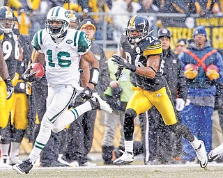 New York Jets' Brad Smith (16) returns the opening kickoff Pittsburgh Steelers safety Will Allen (26) for a touchdown) in the first quarter of the NFL football game, Sunday, Dec. 19, 2010 in Pittsburgh.