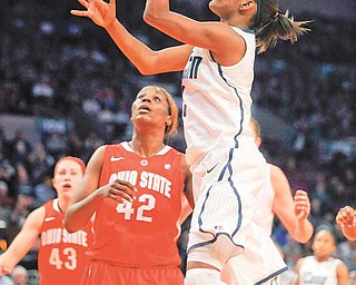Connecticut's Tiffany Hayes, right, shoots against Ohio State's Jantel Lavender in the second half of an NCAA college basketball game in the Maggie Dixon Classic at Madison Square Garden in New York, Sunday, Dec. 19, 2010. Connecticut won its 88th game in a row, 81-50.
