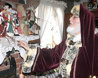 Howard Huffman, 64, points to the collection of Santa memorabilia he has collected for the past 20 years. The Hubbard resident likes the vintage, nontraditional look of the dolls he's collected from different countries.