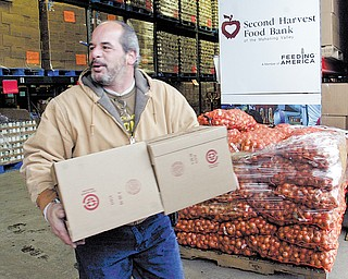 Joe Dantona of East Liverpool picks up food from the Second Harvest Food Bank of the Mahoning Valley. Dantona is a volunteer with the Nehemiah Network, one of more than 150 hunger-relief organizations that distribute food from Second Harvest.