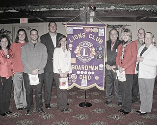 The pride of new Lions: Boardman Lions Club had its Christmas dinner at the Saxon Club on Dec. 9. Lion Bill Rausch, the new zone chairman of District 13-D Zone 5, installed five new members. From left to right are President Mary Beth Shobel; Director Jaclyn Rausch; new members Bob Pavalko, Lee Ward, Mandy Ward, John Landers and Kathy Collins; Rausch; and Director Karen Kannal.