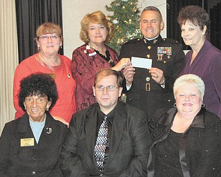 Helping to get Toys for Tots: At their annual Toys for Tots auction the Warren Republican Women's Club raised $1,368 for the Marine Corps' annual campaign to help area children at Christmas. They presented the check to a Marine representative Dec. 2 at DiLucia's banquet center in Warren. In the front row, from left to right, are Shelby McElravy, second vice president and auction chairwoman; Mike Fuchilla, auctioneer; and Cary Ann Koren, first vice president. In the second row are Gail Druschel, auction committee member; Barbara Tryon, president; Chief Warrant Officer 4 Emiliano DeLeon of Toys for Tots, who is holding the check; and Dorie Harris, hostess.