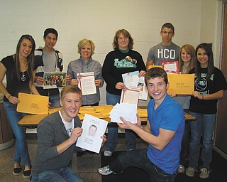 For a second year, students in West Branch High School's mentoring program, Freshmen Focus, participated in The Vindicator's Operation Holiday Cheer project. The students chose 16 servicemen and women, some of whom are graduates of West Branch, to send Christmas cards and letters. Pictured, from left, are: first row, Robert Brand (12th grade) and Zach Altman (12th grade), and second row, Taylor Metzgar (12th grade), Parker Zamarelli (9th grade), Mrs. Erica Polinori (mentor teacher), Mrs. Brenda Sharp (mentor teacher), Kahliel Fletcher (9th grade), Molly Wyss (9th grade) and Hayley Kozar (9th grade). Freshmen Focus is a yearlong mentoring program in which 11th- and 12th-grade students mentor freshmen.