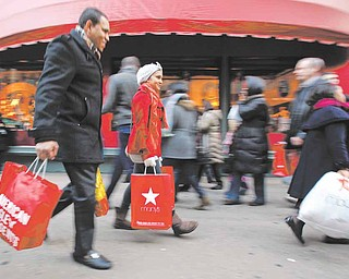 In this Dec. 18, 2010 photo, shoppers are photographed on 34th Street, in New York. Holiday shoppers are racing to the end of the season at a more feverish pace this year, with retail revenue up 5.5 percent during the last weekend before Christmas.