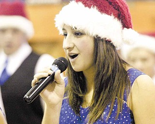 Alyssa Carline, a sophomore, introduces herself during a concert put on the by the Poland High School show choir at Union Elementary.