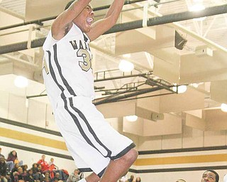 (34) Tre' Brown of Harding slams home two points Wednesday night in Warren.