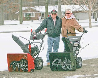 "Doug and Sharon Carlile, of West Glen Drive in Boardman, are constantly helping out their neighbors. During the winter they clear snow from others' driveways, They also take care of the devil strip on the cul de sac. In the summer they mow grass and mulch the trees and in the fall they rake leaves. The couple was one of two nominated by a neighbor to The Vindicator's ""Random Acts of Snow Kindness"" contest."