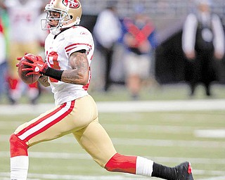 San Francisco 49ers' Ted Ginn runs a punt back 78-yards for a touchdown during the second quarter of an NFL football game against the St. Louis Rams, Sunday, Dec. 26, 2010, in St. Louis.