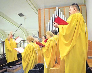Members of the choir at St. Stanislaus Kostka Catholic Church sang Sunday during the church's last Polish mass. Father Ed Naroda, who has been with the church for 30 years, said he will only hold one mass in English each Sunday, at 10:30 a.m., due to his health.