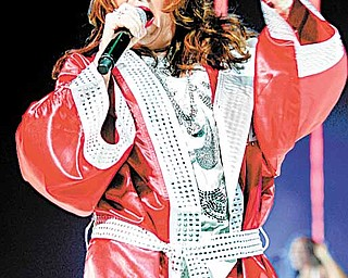"In this July 5, 2009 file photo, Teena Marie performs during the Essence Music Festival at the Louisiana Superdome in New Orleans. Marie, who made history as Motown's first white act but developed a lasting legacy with her silky soul pipes and with hits like ""Lovergirl,"" ""Square Biz,"" and ""Fire and Desire"" with mentor Rick James, has died. She was 54."