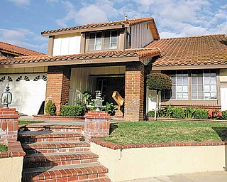 This March 9, 2009 file photo shows the house in which Nadya Suleman, mother of octuplets, has been living in for nearly two years in La Habra, Calif. The man who sold the home to Suleman says he is going ahead with eviction proceedings because she can't come up with a $450,000 balloon payment.