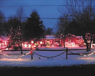Marian and Raymond Beil have been lighting up their house in North Lima for 43 years and still love doing it!