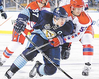 Pittsburgh Penguins' Sidney Crosby (87) is held by Washington Capitals' Mike Green in the first period of the NHL Winter Classic outdoor hockey game in Pittsburgh, Saturday, Jan. 1, 2011.