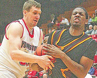 YSU's Dan Boulder fights with (23) Geoff McCammon for the ball during their game Saturday afternoon.
