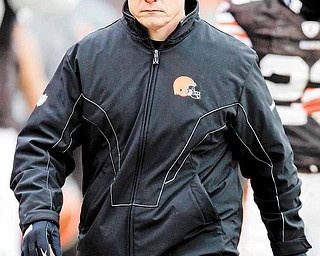 Cleveland Browns coach Eric Mangini walks to the locker room after the first half of an NFL football game against the Pittsburgh Steelers on Sunday, Jan. 2, 2011, in Cleveland. (AP Photo/Tony Dejak)