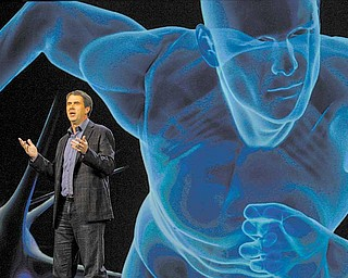 In this Jan. 6, 2010 file photo, Microsoft Entertainment and Devices Division President Robbie Bach speaks during CEO Steve Ballmer's keynote address at the International Consumer Electronics Show (CES) in Las Vegas. The International Consumer Electronics Show, which kicks off this week in Las Vegas. It's the largest trade show in the Americas, and organizers expect attendance to be as strong as last year.