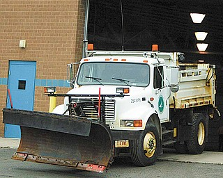 Another truck done- an ODOT snow/slag truck leaves the inspection garage at the Canfield Facility.