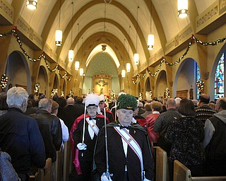 Knights of Columbus exit the church during the final service. Parish members said they felt as if they had lost a member of the family when the church announced it would close.