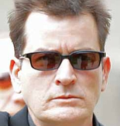 "Charlie Sheen waves as he arrives at the Pitkin County Courthouse in Aspen, Colo., for a hearing in his domestic abuse case. Appearing on ABC's ""Good Morning America"" on Monday, Nov. 22, 2010, adult-film actress Capri Anderson, the woman found in Charlie Sheen's New York hotel room last month, says the actor hurled racial slurs, threw a lamp at her and grabbed her by the throat. She says she's suing Sheen for battery and false imprisonment, and plans to file a criminal report with New York police."