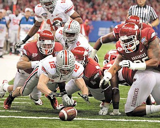 Ohio State wide receiver Dane Sanzenbacher (12) dives on a fumble in the end zone for a touchdown against Arkansas during the Sugar Bowl NCAA college football game at the Louisiana Superdome in New Orleans, Tuesday, Jan. 4, 2011. (AP Photo/Patrick Semansky)