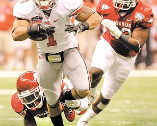Ohio State running back Dan Herron (1) rushes during the second quarter of the Sugar Bowl NCAA college football game at the Louisiana Superdome in New Orleans, Tuesday, Jan. 4, 2011. (AP Photo/Patrick Semansky)