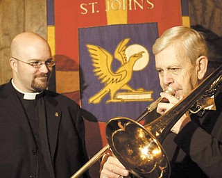 James Hummer plays the trombone for the Rev. Dr. Bradley Pace, rector of St. John's Episcopal Church in Youngstown. In the brass ensemble, Hummer has participated in all 50 years of the Boar's Head and Yule Log Festival. The Rev. Dr. Pace, who became rector at St. John's last summer, will be a first-time pageant participant at the Sunday event.