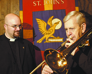 William d Lewis The vindicator  Rev Bradley Pace, Rector of St John's Episcopal Church in Youngstown, left, and Jim Hummer of Boardman who has played in annual Boar's Head Festival in sanctuary of church.