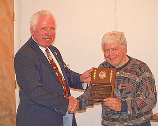 Trumbull County Tourism Bureau elected three new trustees during its semiannual meeting at Cortland Wine Cellar. During the event, outgoing trustee Jerry Usselman, left, also presented the organization's first Presidential Award to David H. Hamilton, who was recognized for his years of service to the community.