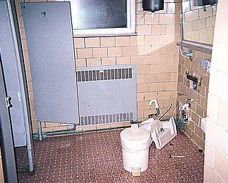 This bathroom, also photographed Dec. 15, shows broken and unclean fixtures. Area Agency on Aging 11 provided The Vindicator with the photos, shot to augment the state's monitoring of the facility.